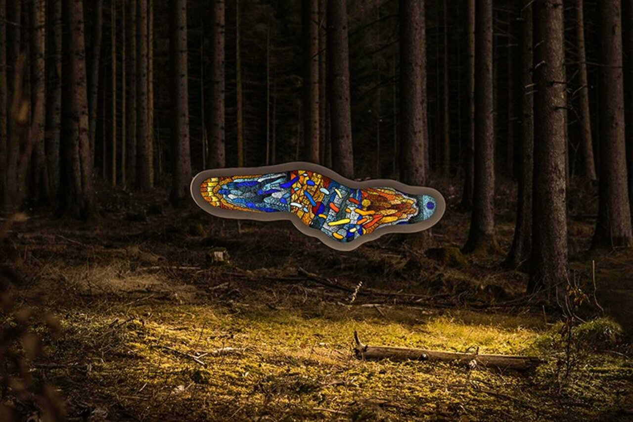Thomas Medicus sets surreal stained glass amoeba sculpture in the woods https://t.co/YRnQB8sata